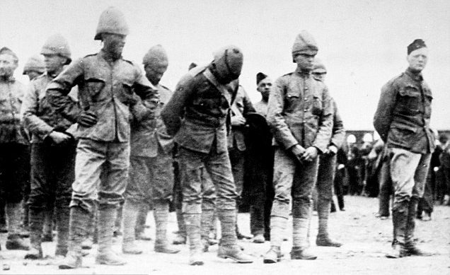 Winston Churchill (right) with other captured prisoners of war during the Boer War.