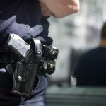Police officer with handgun in holster